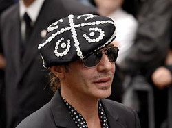 Dior suspends designer John Galliano after arrest